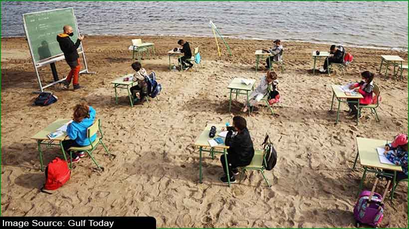 children-in-spain-swap-classrooms-for-the-beach