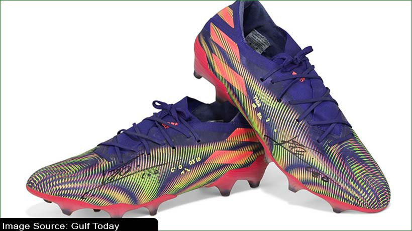 football-legend-messi-donates-record-making-boots-to-charity