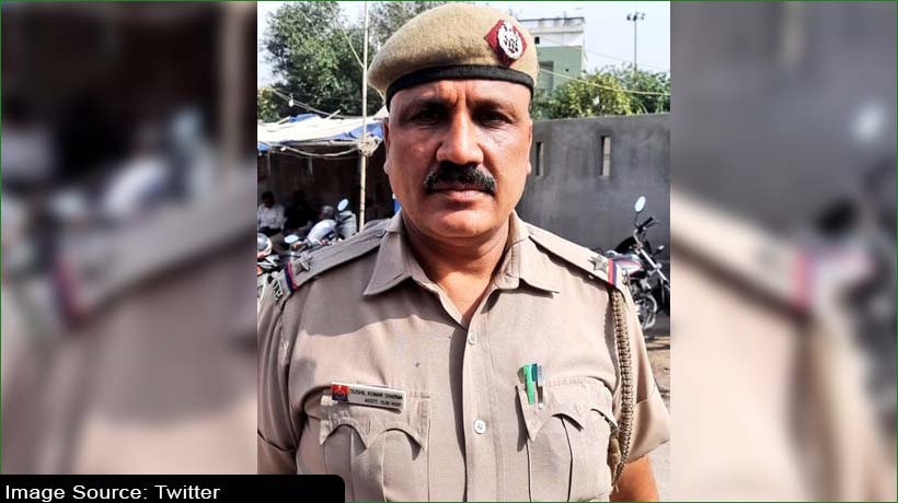 Cop goes beyond duty for COVID-19 victim's last rites