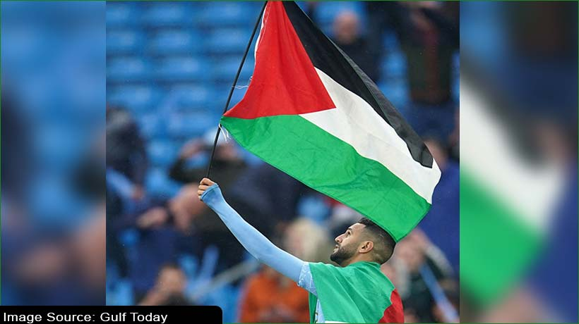 footballer-riyad-mahrez-waves-palestinian-flag-as-man-city-celebrate-title