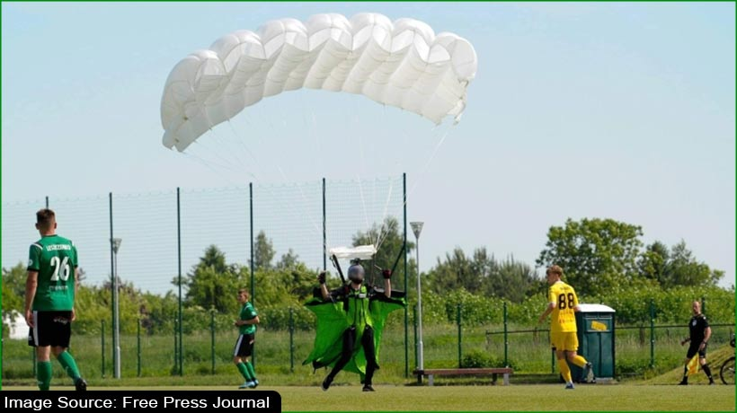 parachutist-lands-in-middle-of-soccer-match-in-poland