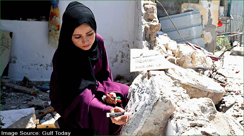 young-palestinian-uses-broken-tiles-of-her-home-for-art