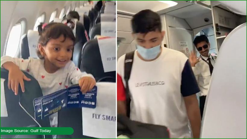 kid-giggles-as-she-spots-papa-as-pilot-of-the-flight